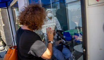 A woman waving to her mother on the coronavirus ward at the Herzog Medical Center in Jerusalem last week.