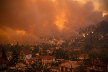 A photograph shows the wildfire moving towards the village of Gouves on Evia (Euboea) island, second largest Greek island, last week.