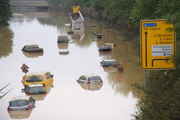 Submerged cars and other vehicles are seen on the federal highway in Erftstadt, western Germany, after heavy rains hit parts of the country, causing widespread flooding and major damage, last month.