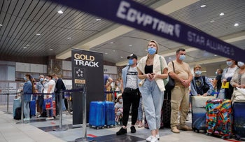 Russian tourists gather at the Egyptair check-in desk at the Domodedovo International Airport outside Moscow, Monday.