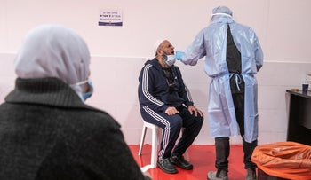 A man receives a coronavirus test in the Arab-majority town of Taibe in northern Israel, March 2021