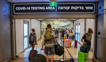 New arrivals heading to or exiting the mandatory COVID test after landing at Ben-Gurion Airport, earlier this month.