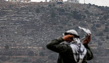 A Palestinian protester near the Israeli settlement outpost of Evyatar, last month.
