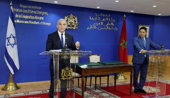 Israeli Foreign Minister Yair Lapid, left, at a news conference with Moroccan Foreign Minister Nasser Bourita in Rabat, Morocco.