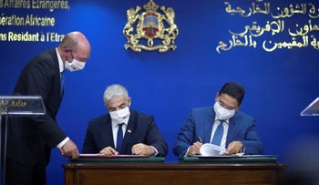 Foreign Minister Yair Lapid and his Moroccan counterpart Nasser Bourita sign cooperation agreements between the two countries, in Rabat, Morocco, Wednesday.