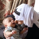 Ali Duikat, father of Imad who was killed last Friday, cradling his grandson and namesake, this week.