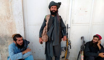 Taliban fighters are seen inside the city of Farah, Afghanistan, Wednesday.
