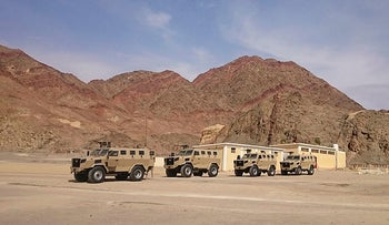 Four Hummer Military Cars in the Egyptian Army and the Background is South Sinai Mountains, 2017.