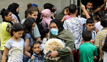 People waiting in line for bread in a Beirut suburb on Friday.