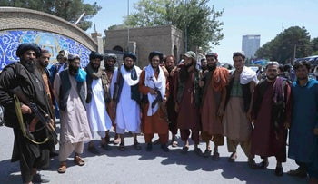 Taliban fighters in front of the provincial governor's office in Herat on Saturday.
