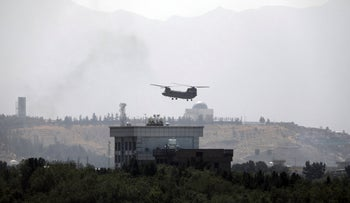 A U.S. Chinook helicopter flies over the U.S. Embassy in Kabul, Afghanistan, on Sunday.