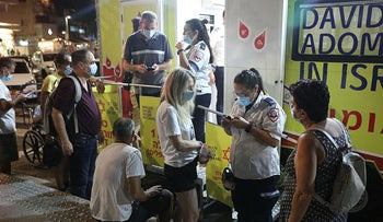 People lining up to get vaccinated in central Tel Aviv, on Saturday night.
