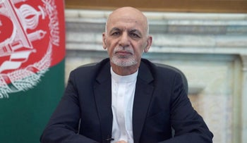 Afghanistan's President Ashraf Ghani addresses the nation in a message in Kabul, Afghanistan, on Saturday.