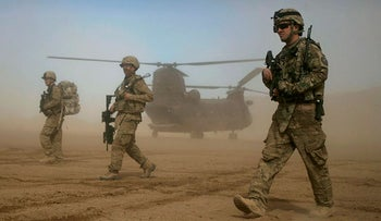 U.S. soldiers, part of the NATO- led International Security Assistance Force (ISAF) patrol west of Kabul, Afghanistan