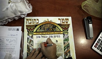 A Ketubah, traditional Jewish wedding contract detailing the groom's responsibilities toward the wife