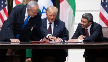 Former Prime Minister Benjamin Netanyahu (L), former U.S. President Donald Trump, and UAE Foreign Minister Abdullah bin Zayed Al-Nahyan (R) participate in the signing of the Abraham Accords at the White House in Washington, last year.