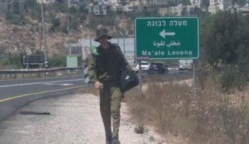 Palestinian wearing an IDF uniform in the West Bank, August 16 2021.