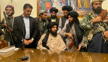 Taliban fighters in the Afghan presidential palace, on Sunday