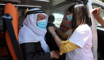 A 90-year-old Bedouin man receiving a third dose of a COVID-19 vaccine in Rahat, on Monday.