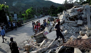 A collapsed building in Saint-Louis-du-Sud, Haiti, yesterday, two days after a 7.2-magnitude earthquake.