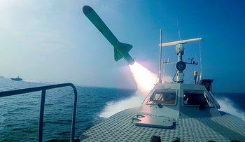 A Revolutionary Guard's speed boat fires a missile during a military exercise, last year.