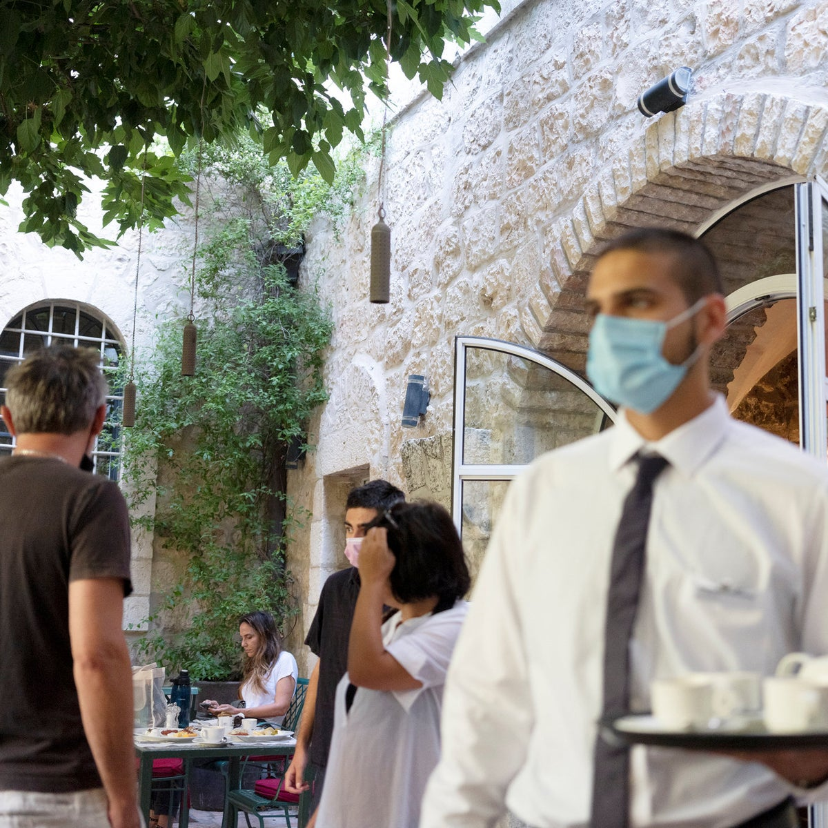 A waiter serves drinks to guests at the American Colony Hotel in East Jerusalem.