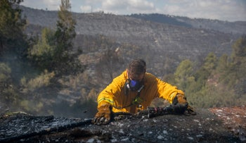 A firefighter on the second day of a massive fire in the Jerusalem area, Monday.