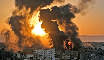Heavy smoke and fire rise from Al-Sharouk tower as it collapses after being hit by an Israeli air strike, in Gaza City in May.