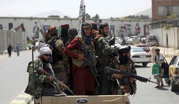 Taliban fighters patrol in Kabul, Afghanistan, today.