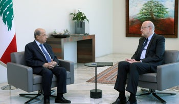 President Michel Aoun and premier-designate Najib Mikati at the presidential palace in Beirut on Monday.