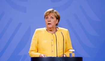 German Chancellor Angela Merkel at a news conference on the current developments in Afghanistan, at the Chancellery in Berlin, Germany, on Monday.