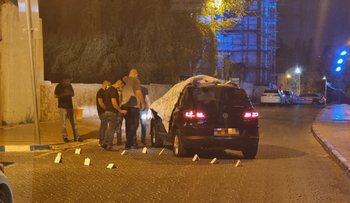 The car in which a woman was shot dead in Ramle, today.