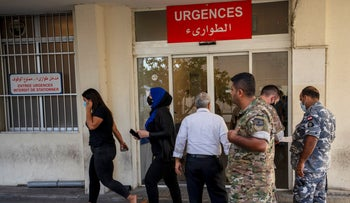 Relatives of people who were severely injured in a fuel explosion in northern Lebanon gather outside a Geitaoui hospital in Beirut, Lebanon, last week.