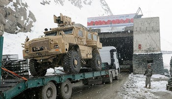 U.S. military convoy entering the Salang Tunnel, where a substation for the PTEC was planned