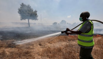 A firefighter works in southern Israel, Monday.