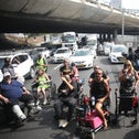 Disabled Israelis protesting on a highway in Tel Aviv.