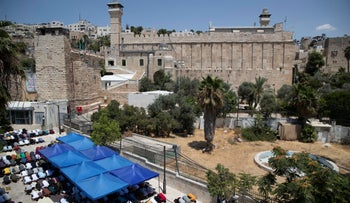 Palestinians pray during Friday prayers at a protest against construction on the Jewish side at the Ibrahimi Mosque, which Jews call the Tomb of the Patriarchs, in the West Bank city of Hebron, this month.