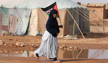 Saharawi refugee woman heading to a ceremony in the Laayoune refugee camp near the Saharawi border with Algeria