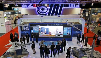 Visitors watch a demonstration of the Israel Aerospace Industries in Singapore, 2015