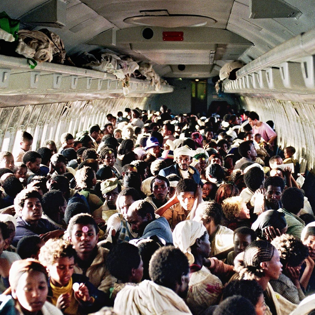 Ethiopian Jews sitting on an Israel Air Force Boeing 707, during their evacuation from Addis Ababa to Tel Aviv, May 25, 1991.