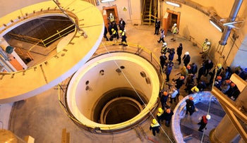 Technicians at the Arak heavy water reactor's secondary circuit, as officials and media visit, December 2019.