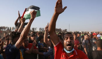 Palestinians shout slogans as they protest along the border fence, east of Khan Yunis in the southern Gaza Strip, on Wednesday.