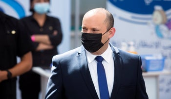 Prime Minister Naftali Bennett during a visit to a clinic in Taibeh, last week.