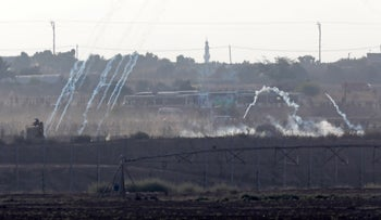 Israeli tear gas fired at protesters at the Gaza border fence on Wednesday.