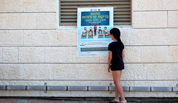 A girl reading coronavirus instructions at a school in Rishon Letzion this week.