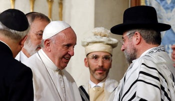 Pope Francis is greeted as he arrives at Rome's Great Synagogue, Italy, 2016.