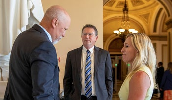 From left, Rep. Chip Roy, R-Texas, Rep. Thomas Massie, R-Ky., and Rep. Marjorie Taylor Greene, R-Ga. talk on Capitol Hill in Washington, on Tuesday.