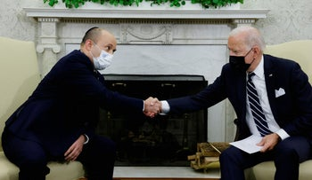 U.S. President Joe Biden and Israel's Prime Minister Naftali Bennett shake hands during a meeting in the Oval Office at the White House in Washington, U.S. today.
