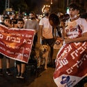 Israeli parents protest the admission of asylum seekers' children to the Kfir School in south Tel Aviv, on Wednesday.