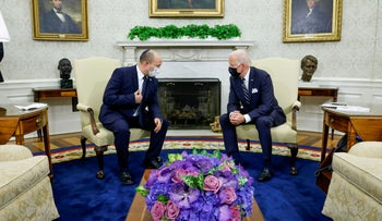 U.S. President Joe Biden and Israel's Prime Minister Naftali Bennett chat during a meeting in the Oval Office at the White House in Washington, last week.